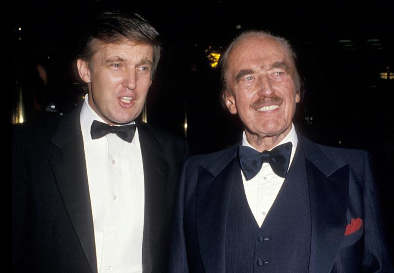 """Donald Trump and Fred Trump celebrate the publication of """"The Art of The Deal"""" at Trump Towers atrium in New York City, 1987. (Photo: Ron Galella/WireImage)"""
