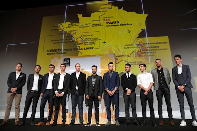 Tour de France riders pose in front of the map of the itinerary of the 2018 Tour de France cycling race during a news conference in Paris, France, October 17, 2017. The world's greatest cycling event will start from Noirmoutier-en-L'Ile on July 7 and will finish at the Champs Elysees in Paris on July 29. REUTERS/Charles Platiau