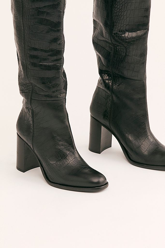 """<br><br><strong>FP Collection</strong> Grayson Tall Boots, $, available at <a href=""""https://go.skimresources.com/?id=30283X879131&url=https%3A%2F%2Fwww.freepeople.com%2Fshop%2Fgrayson-tall-boot%2F"""" rel=""""nofollow noopener"""" target=""""_blank"""" data-ylk=""""slk:Free People"""" class=""""link rapid-noclick-resp"""">Free People</a>"""