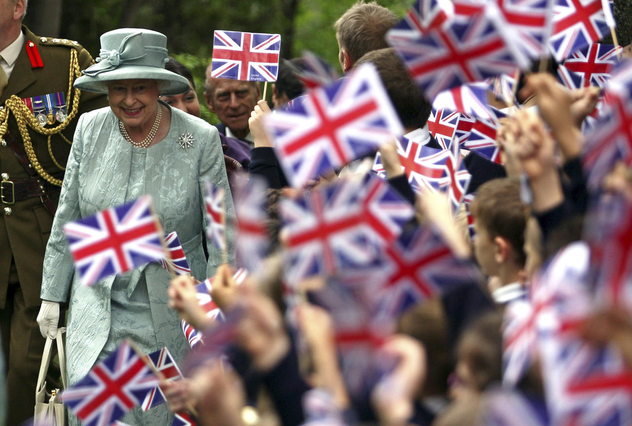 FILE - In this May 16, 2008 file photo, Britain's Queen Elizabeth II, left, is welcomed by children waving Britain's flag, upon her arrival at the British Embassy in Ankara, Turkey. Encouraged by the largely successful peace process in Northern Ireland, which has made her sensitive visit feasible, the queen will become the first British monarch to set foot in the Republic of Ireland on Tuesday, May 17, 2011. When a British sovereign last came, a full century ago, all of Ireland was still part of the United Kingdom.