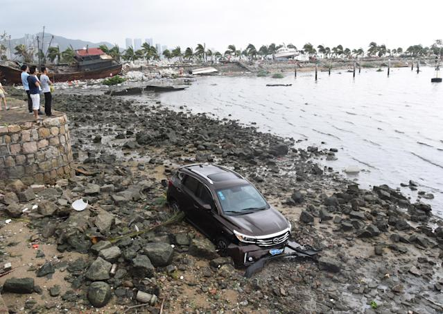 <p>A car is swept away from road in Zhuhai, south China's Guangdong Province, Aug. 23, 2017. (Photo: Lu Hanxin/Xinhua via ZUMA Wire) </p>