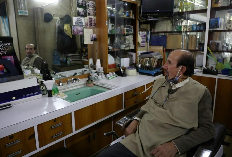Civil war survivor Victor Abu Kheir, 77, in his barber shop in the Lebanese capital Beirut's Hamra neighbourhood
