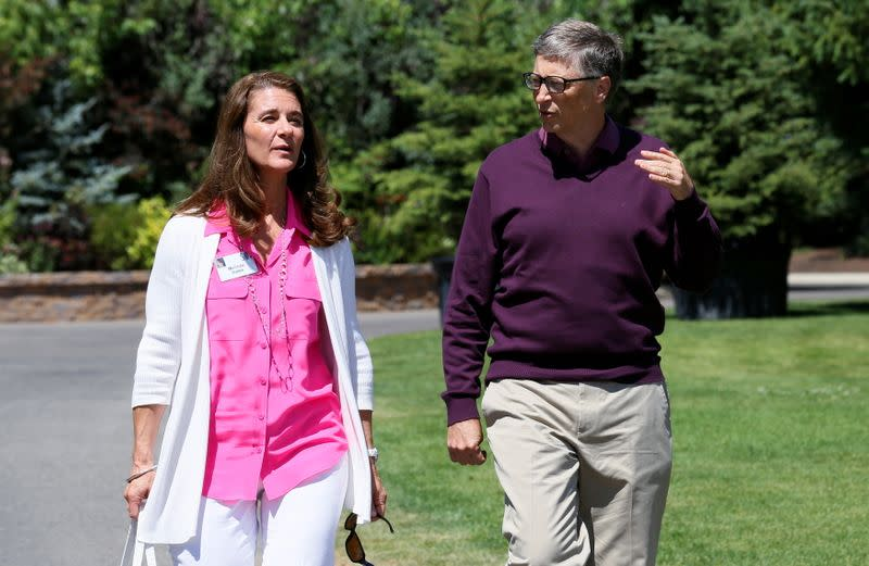 FILE PHOTO: Microsoft technology advisor Bill Gates and his wife Melinda leave on the second day of the Allen and Co. media conference in Sun Valley, Idaho