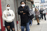Jakaya Lewis, left, waits in line with her mother Trina Ayers to get tested for COVID-19 at an urgent care clinic in Newark, N.J., Monday, Oct. 26, 2020. Gov. Phil Murphy has once again signed an executive order to extend New Jersey's public health emergency, citing a steep increase in coronavirus cases in recent days. (AP Photo/Seth Wenig)