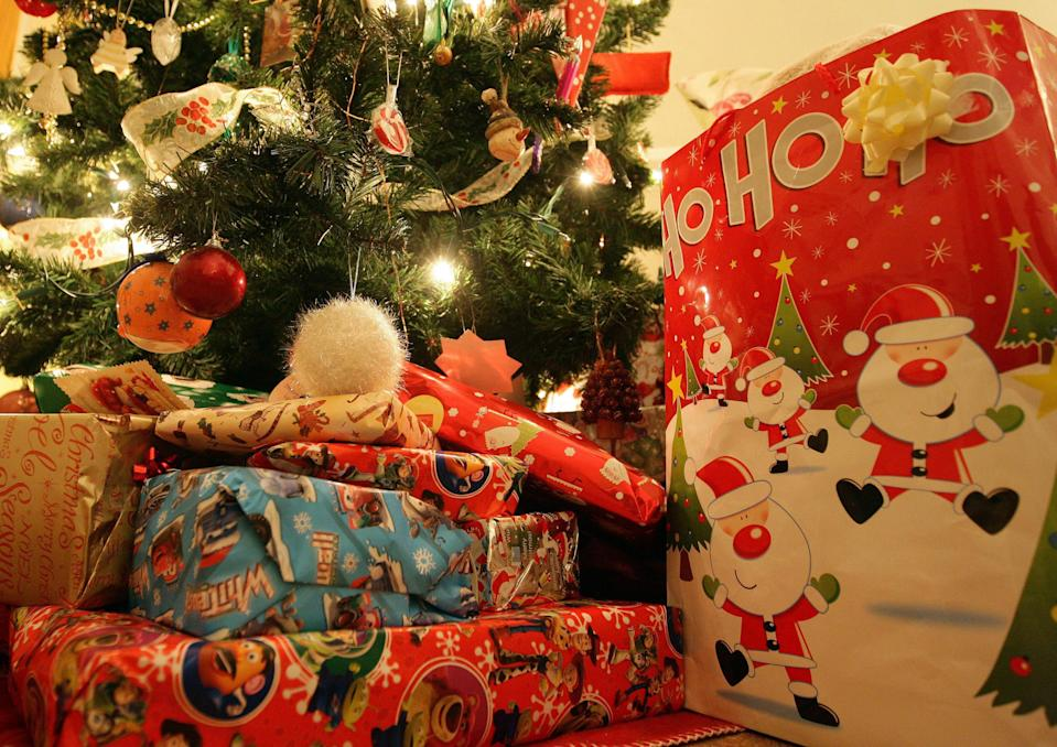 Wrapped presents under a Christmas tree.