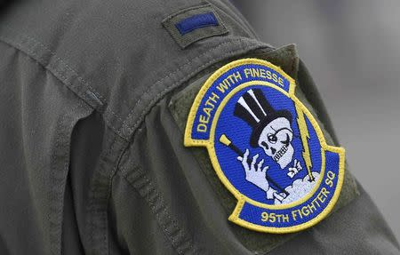 A squadron badge is seen on the uniform of a U.S. F-22 Raptor fighter pilot at R.A.F. Mildenhall in Britain, April 25, 2016. REUTERS/Toby Melville