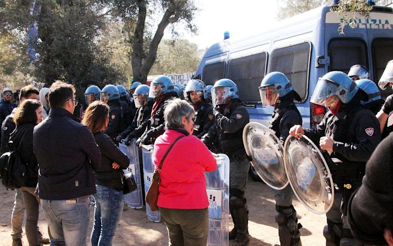 A standoff between protesters and police at the pipeline construction site in Puglia in southern Italy - Splash News