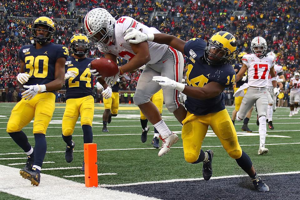ANN ARBOR, MICHIGAN - NOVEMBER 30: J.K. Dobbins #2 of the Ohio State Buckeyes dives for a fourth quarter touchdown past Josh Metellus #14 of the Michigan Wolverines at Michigan Stadium on November 30, 2019 in Ann Arbor, Michigan. (Photo by Gregory Shamus/Getty Images)
