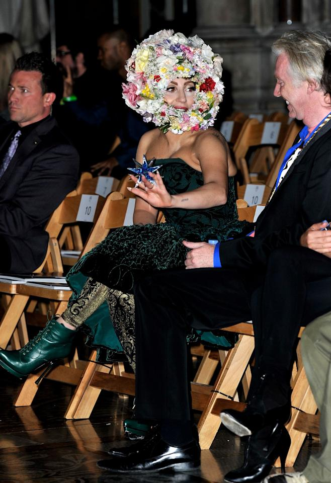 "<p class=""MsoNormal""><span>Lady Gaga, here on the front row for the Philip Treacy show at The Royal Courts Of Justice, also modeled during the show. No word on whether she was pestered by bees. <br></span></p><p class=""MsoNormal""><span>(Photo by Gareth Cattermole/Getty Images)</span></p>"