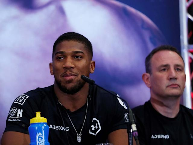 Anthony Joshua and trainer Rob McCracken during the press conference: Action Images via Reuters
