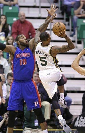 Utah Jazz's Mo Williams (5) shoots as Detroit Pistons' Greg Monroe (10) defends in the first quarter during an NBA basketball game Monday, March 11, 2013, in Salt Lake City. (AP Photo/Rick Bowmer)