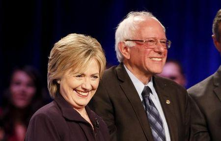 Democratic presidential candidates Hillary Clinton (L) and Bernie Sanders (R) smile at the crowd following the First in the South Presidential Candidates Forum held at Winthrop University in Rock Hill, South Carolina November 6, 2015. REUTERS/Chris Keane
