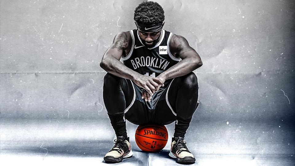 Kyrie Irving treated art, sitting on basketball, looking down with grey background