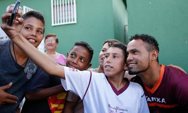 "<span class=""element-image__caption"">Bruno, meeting fans at Boa Esporte.</span> <span class=""element-image__credit"">Photograph: Cristiane Mattos/AFP/Getty Images</span>"