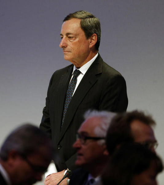 The President of the European Central Bank, ECB, Mario Draghi arrives for his opening speech at the annual meeting of the ruling Christian Democratic Union, CDU, party's Economic Council in Berlin, Germany, Tuesday, June 25, 2013. (AP Photo/Markus Schreiber)