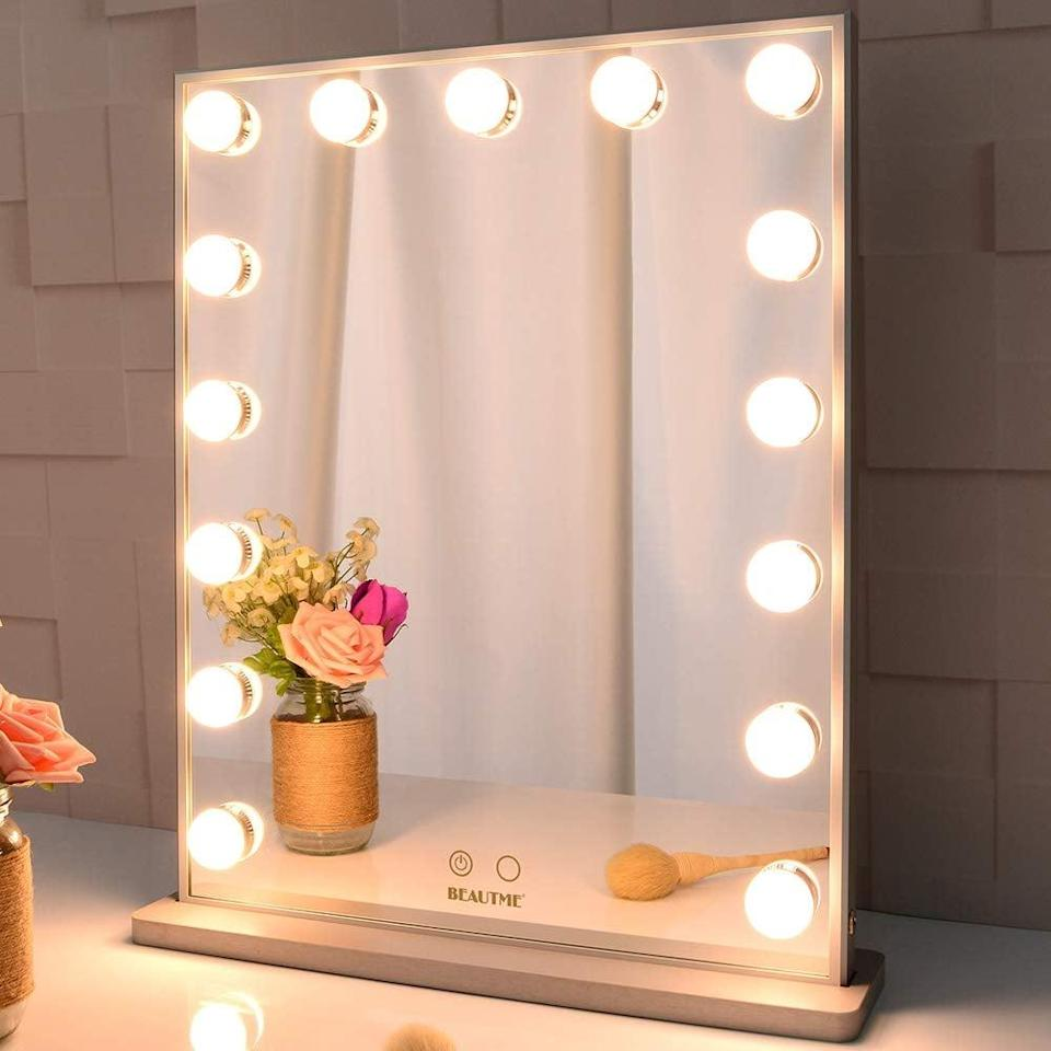 <p>The <span>BEAUTME Standing Tabletop Hollywood Makeup Vanity Mirror with 15 Dimmable Bulbs</span> ($90, originally $95) can sit on your vanity or be wall mounted. It provides both warm and cool lighting.</p>