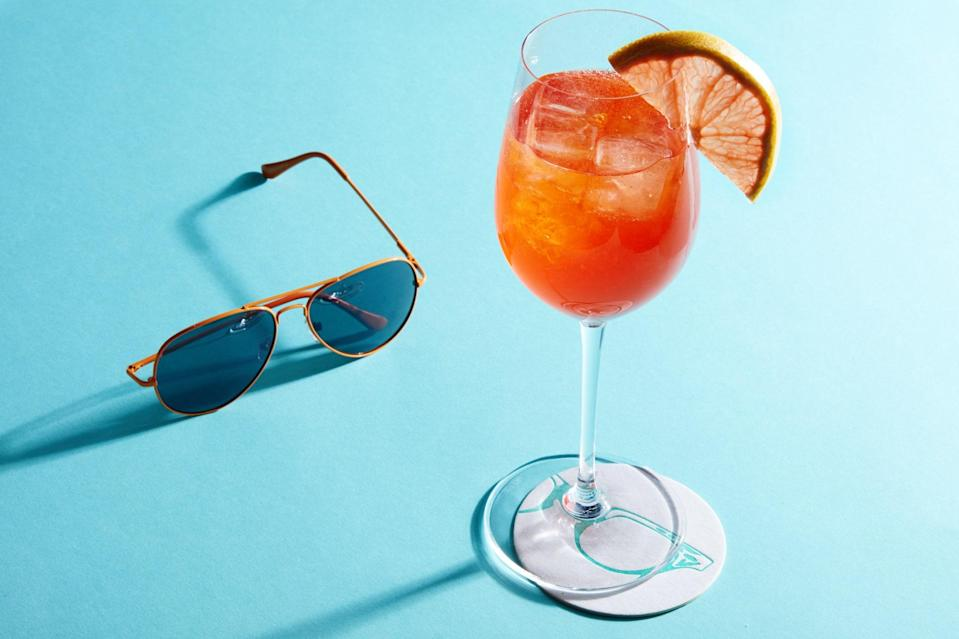 """Fresh grapefruit juice cuts the sweetness of Aperol in this easy spritz recipe. Pair it with an afternoon barbecue. <a href=""""https://www.epicurious.com/recipes/food/views/the-spring-spritz?mbid=synd_yahoo_rss"""" rel=""""nofollow noopener"""" target=""""_blank"""" data-ylk=""""slk:See recipe."""" class=""""link rapid-noclick-resp"""">See recipe.</a>"""