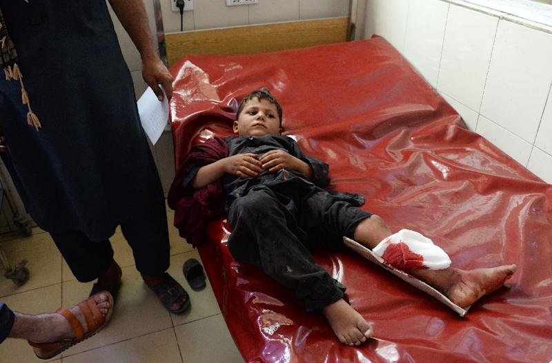 Wounded Afghan boy receives treatment at a hospital following multiple explosions in Jalalabad