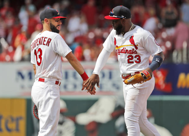 St. Louis Cardinals' Matt Carpenter, left, and Marcell Ozuna celebrate following a baseball game against the Cincinnati Reds, Sunday, July 15, 2018, in St. Louis. (AP Photo/Jeff Roberson)