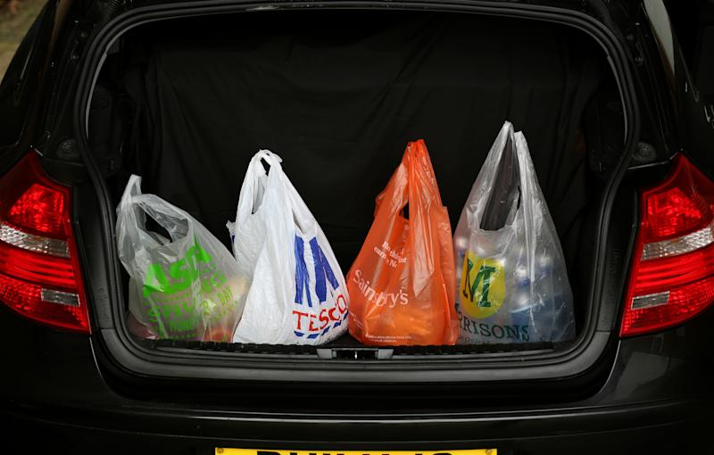 Asda, Tesco, Sainsbury's and Morrisons shopping bags in a car boot. Photo: Chris Radburn/PA Archive/PA Images