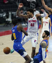 Detroit Pistons forward Saddiq Bey (41) loses control of the ball as Denver Nuggets center Bol Bol (10) defends during the second half of an NBA basketball game, Friday, May 14, 2021, in Detroit. (AP Photo/Carlos Osorio)