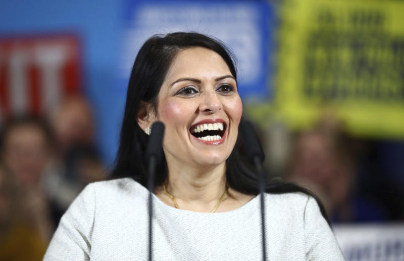 Britain's Home Secretary Priti Patel speaks during a rally event as part of the General Election campaign, in Colchester, England, Monday, Dec. 2, 2019. British Prime Minister Boris Johnson and main opposition Labour Party leader Jeremy Corbyn paused to honor the two people killed in the London Bridge attack, then went back to trading blame for the security failings that allowed a man who had been jailed for terrorist crimes to go on a violent rampage in the heart of London. (Hannah McKay/Pool Photo via AP)