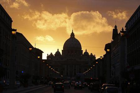 Saint Peter's Basilica at the Vatican is silhouetted during sunset in Rome, March 11, 2013. REUTERS/Paul Hanna/File Photo