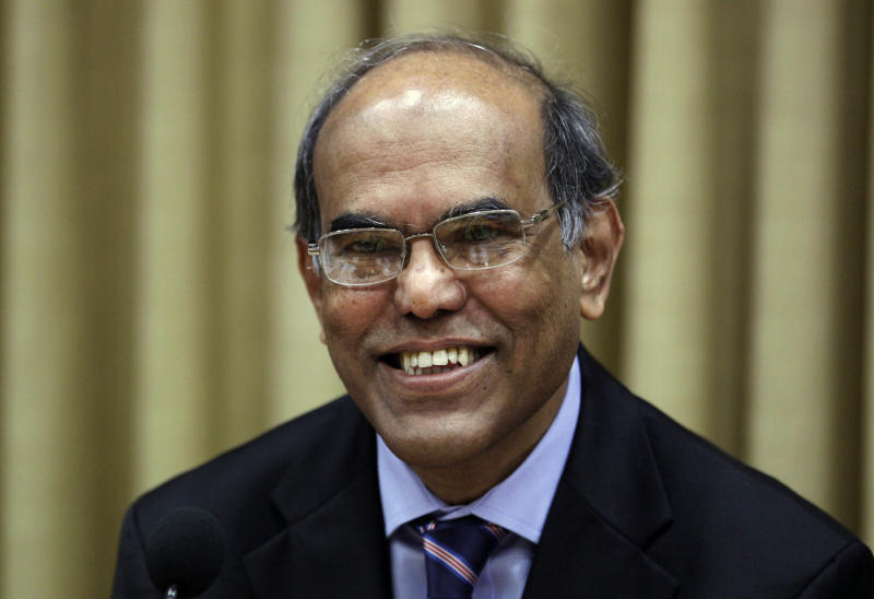 Reserve Bank of India (RBI) Governor Duvvuri Subbarao smiles during a monetary policy review meeting in Mumbai, India, Tuesday, July 31, 2012. India's central bank kept its key interest rate on hold Tuesday because of high inflation and warned that a weak monsoon and intensifying global risks will drive down growth faster than anticipated in Asia's third largest economy.( (AP Photo/ Rajanish Kakade)