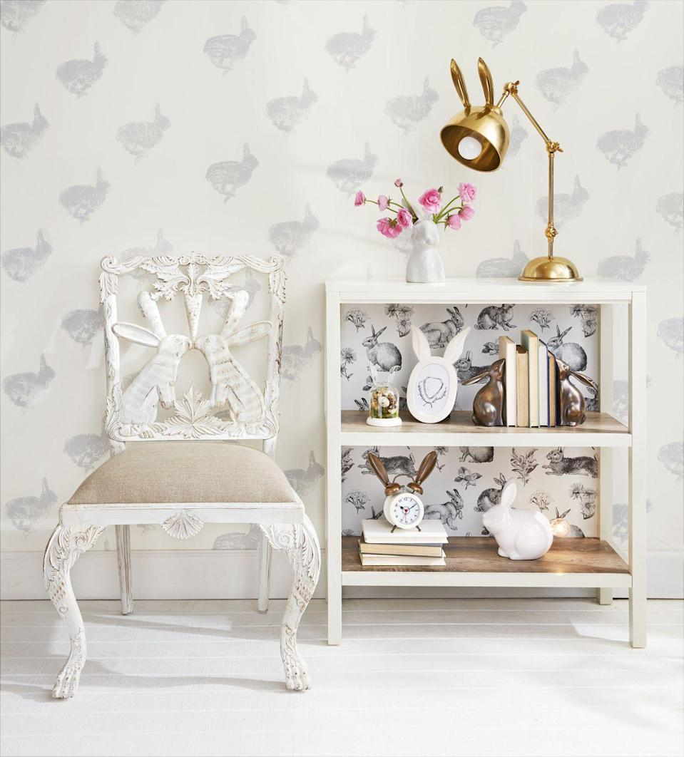 """<p>We're head bunny ears over heels for this festive setup. Update your bookshelves with hare-inspired decorations, and consider scoping out a local antique shop for some must-have vintage seating in the spirit of the holiday. </p><p><a rel=""""nofollow noopener"""" href=""""https://www.potterybarn.com/products/bunny-candy-dish/"""" target=""""_blank"""" data-ylk=""""slk:SHOP EASTER BUNNY DECOR"""" class=""""link rapid-noclick-resp"""">SHOP EASTER BUNNY DECOR</a></p>"""