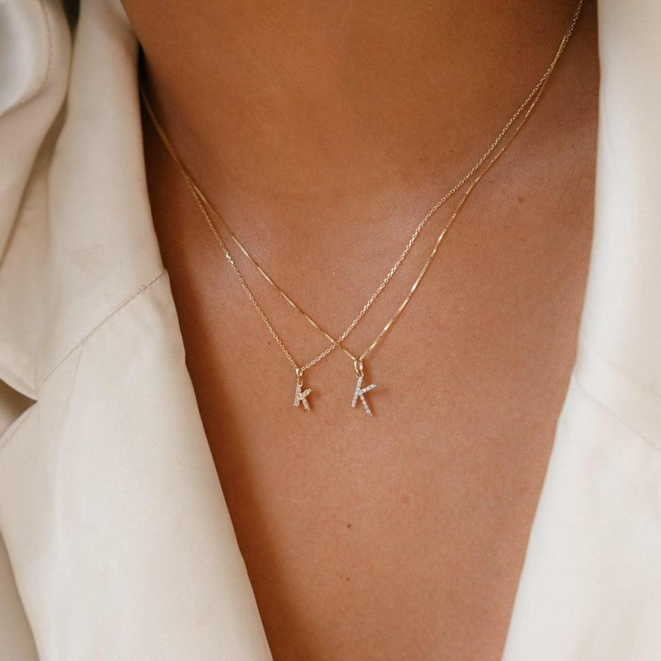 <p>We're firm believers that customized jewelry goes a long way, and this pretty <span>Amarilo Baby Diamond Initial Charm Necklace</span> ($345) will surely make them smile.</p>