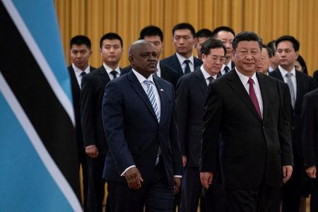 FILE PHOTO - China's President Xi Jinping (R) and President of Botswana Mokgweetsi Masisi arrive for the welcome ceremony at the Great Hall of the People in Beijing
