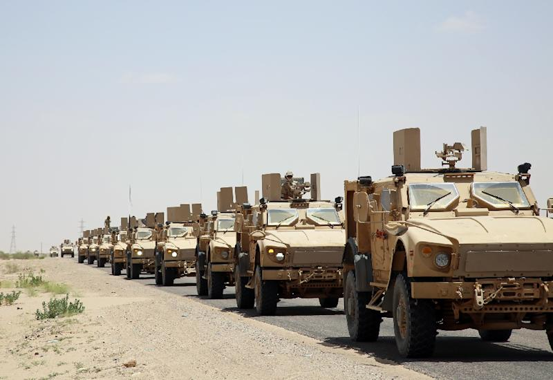 Pro-government forces loyal to Yemen's exiled President Abedrabbo Mansour Hadi drive armored vehicles in Marib province on September 8, 2015 (AFP Photo/Abdullah Hassan)