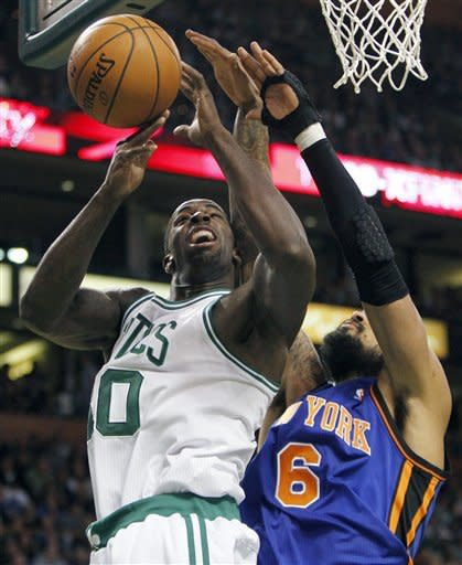 New York Knicks' Tyson Chandler (6) blocks a shot by Boston Celtics' Brandon Bass, in the second quarter of an NBA basketball game in Boston, Sunday, March 4, 2012. (AP Photo/Michael Dwyer)