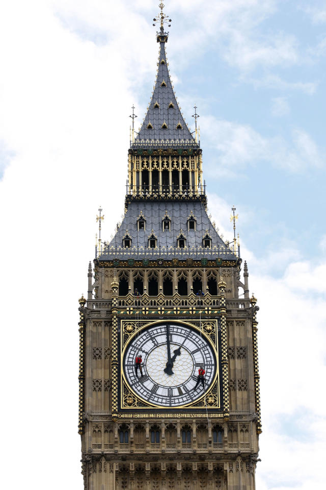 FILE In this Thursday, Aug. 12, 2010 file photo, workers check and repair the external glazing on one of the four faces of the Great Clock on the clock tower, colloquially known as Big Ben after its massive bell, at the Palace of Westminster in London. Experts say the world-famous neogothic clock tower is listing gently, and documents recently published by Britain's Parliament show that the top of its gilded spire is about one-and-a-half feet (nearly half a meter) out of line. (AP Photo/Sang Tan, file)