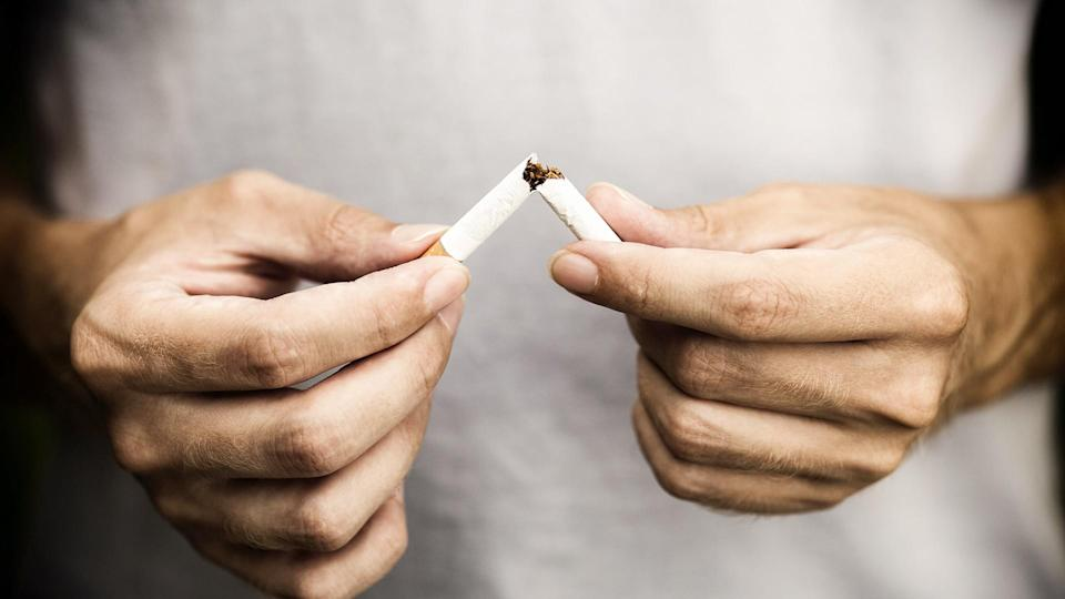 snapping a cigarette in half