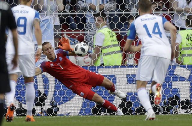 Iceland goalkeeper Hannes Halldorsson saves a penalty by Argentina's Lionel Messi during the group D match between Argentina and Iceland at the 2018 soccer World Cup in the Spartak Stadium in Moscow, Russia, Saturday, June 16, 2018. (AP Photo/Matthias Schrader)