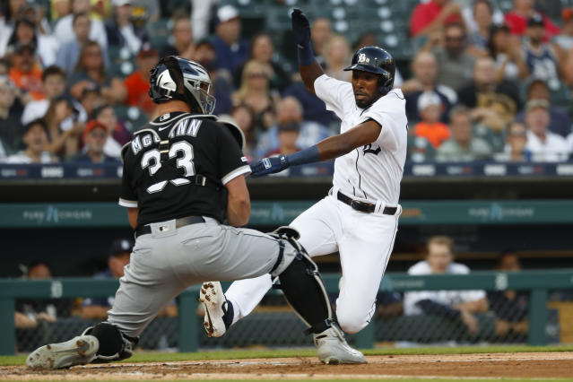 Detroit Tigers' Travis Demeritte slides safely into home plate ahead of the tag by Chicago White Sox catcher James McCann (33) in the second inning of a baseball game in Detroit, Monday, Aug. 5, 2019. (AP Photo/Paul Sancya)