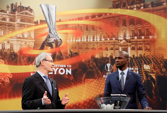Soccer Football - Europa League Quarter-Final Draw - Nyon, Switzerland - March 16, 2018 UEFA competitions director Giorgio Marchetti and Eric Abidal during the draw REUTERS/Pierre Albouy