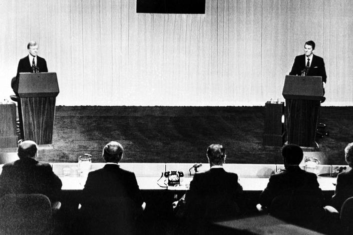 President Jimmy Carter, left, and Republican presidential candidate Ronald Reagan face their panelists during their televised debate at the Cleveland Convention Center in Cleveland, Ohio, on Oct. 28, 1980. (AP)