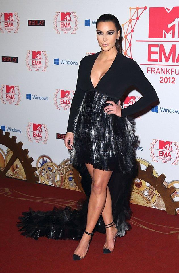 Following in Ms. Swift's footsteps was reality TV titan, Kim Kardashian, who thoroughly impressed us in this low-cut Stephanie Rolland head-turner and strappy, cap-toe stilettos. Dare we declare this Kimmy's best look to date? (11/11/2012)