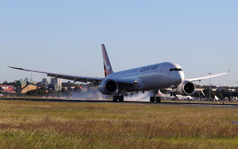 The test flight lands in Sydney after over 19 hours in the air - AFP