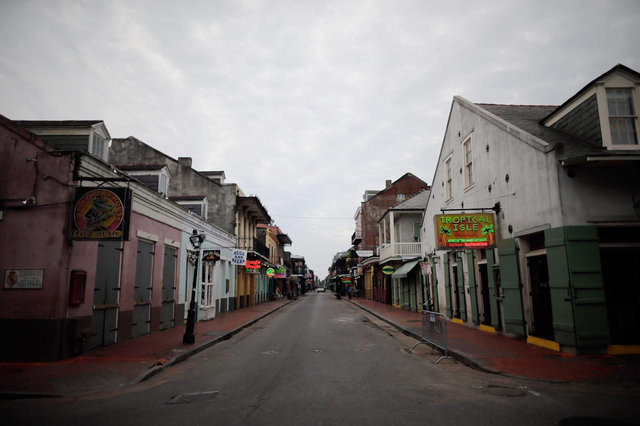 NEW ORLEANS, LA - AUGUST 27:  Bourbon street remains vitrually empty ahead of Tropical Storm Isaac on August 27, 2012 in New Orleans, Louisiana. Tropical Storm Isaac is expected to strengthen into at least a Category 1 hurricane before making landfall near Louisiana.  (Photo by Chris Graythen/Getty Images)