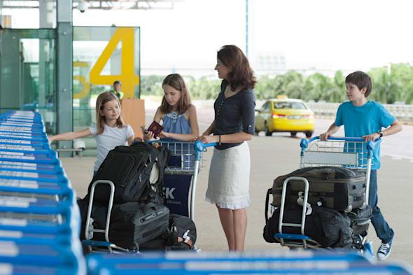 CPN71J Family standing outside of airport with luggage  family; travel; togetherness; airport; journey; voyage; one; parent; fam