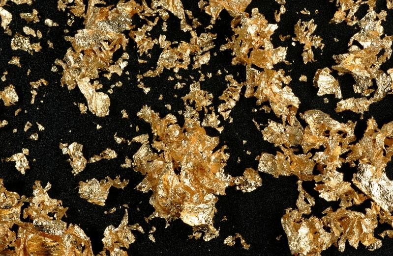 Gold eases as positive trade news boosts risk sentiment