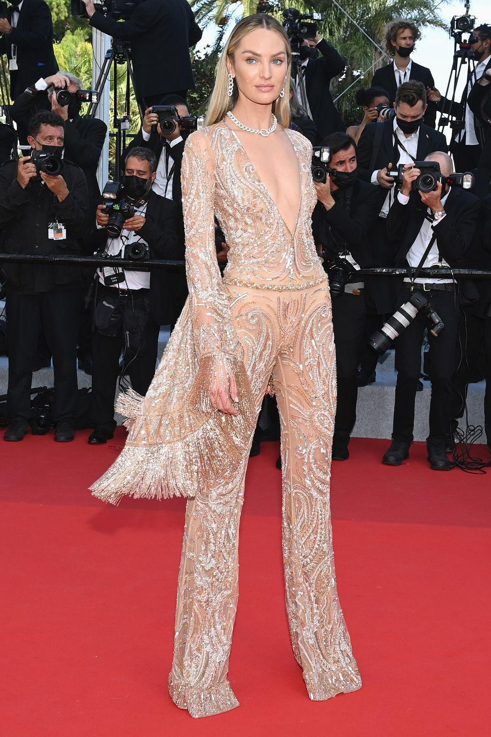 <p>Candice Swanepoel brought some movement to her lace jumpsuit by way of fringed sleeves. </p>