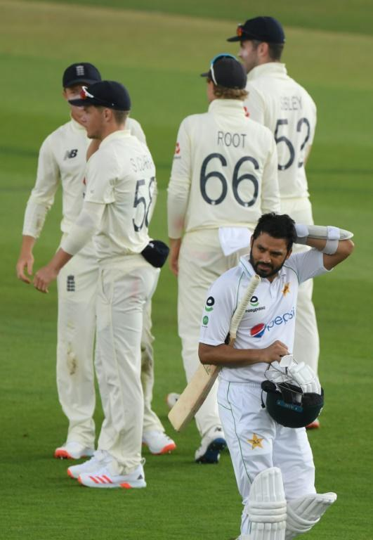 Gone - Pakistan captain Azhar Ali (R) leaves the field after being dismissed for 20 by England's James Anderson on the first day of the second Test at Southampton on Thursday