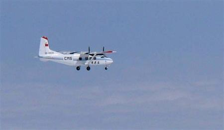 Handout photo of Chinese government plane Y-12 flying north of the the disputed isles, known as Senkaku isles in Japan and Diaoyu islands in China