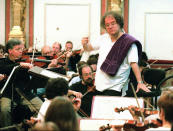 FILE - James Levine conducts the Metropolitan Orchestra of New York during a rehearsal for a performance at Vienna's famed Musikverein on May 11 1996. Levine, who ruled over the Metropolitan Opera for 4 1/2 decades before being eased out when his health declined and then fired for sexual improprieties, died March 9, 2021 in Palm Springs, Calif., of natural causes, his physician of 17 years, Dr. Len Horovitz, said Wednesday, March 17. He was 77. (AP photo/Ronald Zak, File)