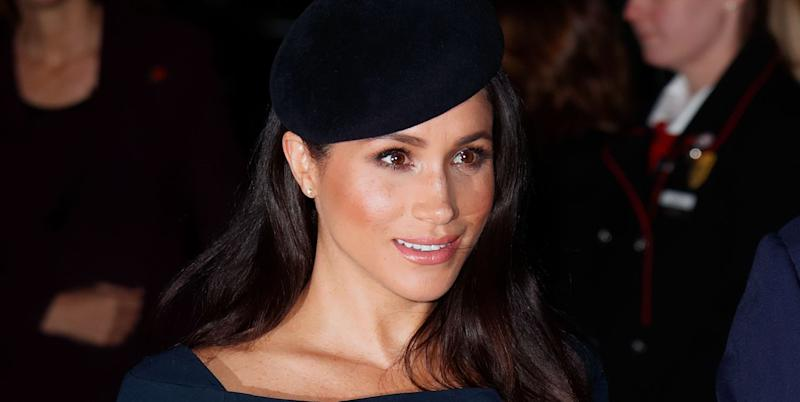 Meghan Markle Hides Her Growing Baby Bump in a Sequin Halter Top
