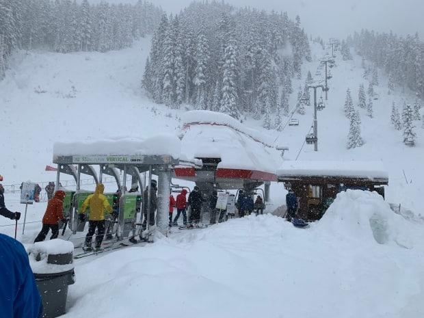 People waiting to get on a lift at Whistler Blackcomb in January 2021.